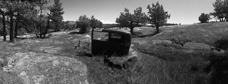 Abandoned car body near homestead