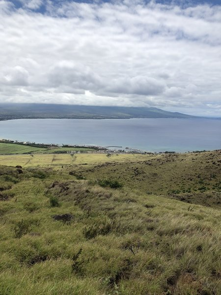 Close to the crest of the trail, looking out towards Kihei and Haleakala National Park (obscured by clouds).