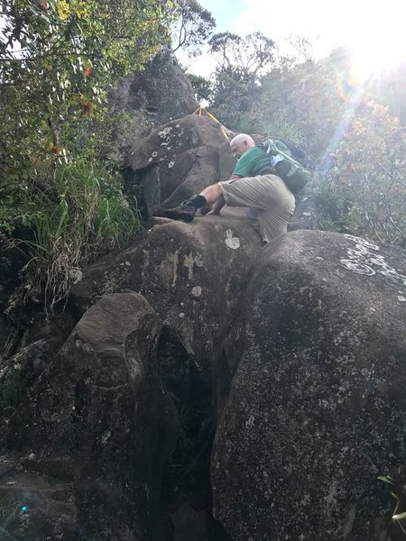 Climbing up the huge rocks using rope