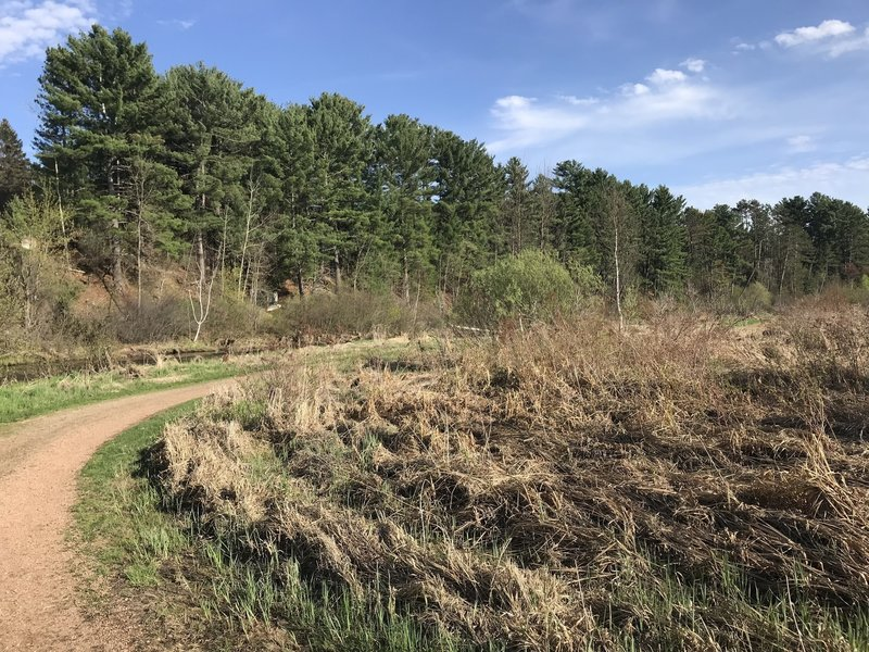 The trail is on a plain that was once flooded, but now is open prairie.