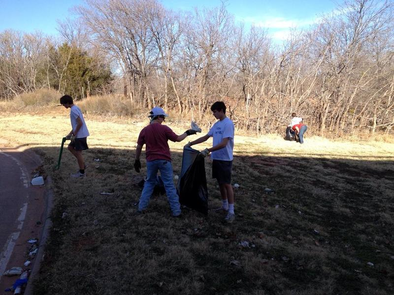 Scouts picking up trash before an event.