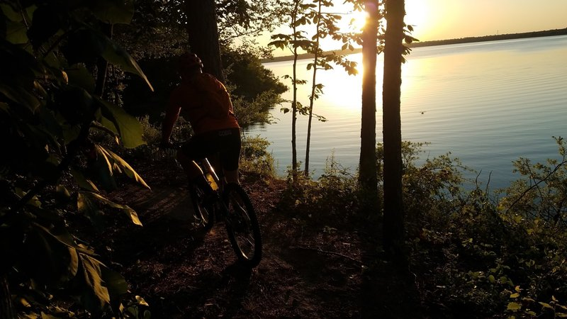 I usually run with a riding partner so he ends up in many pictures. Another view of the lake at sunset