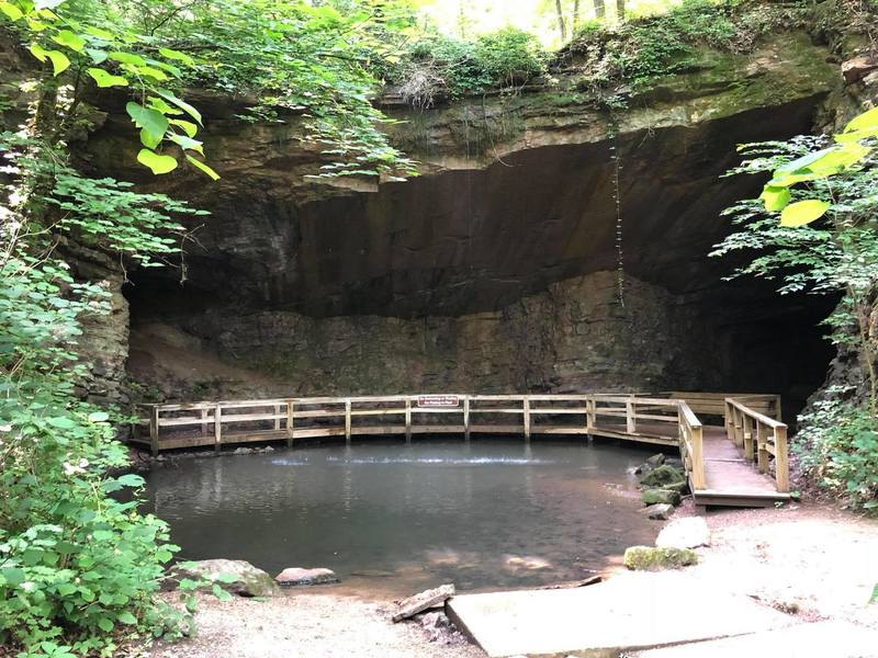 Marble Mine - small cave of marble, with a spring and a small waterfall filling in a small pool of water.