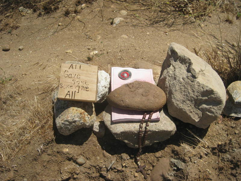Appears to be a memorial for a fallen Marine. The book is CS Forester's Rifleman Dodd.