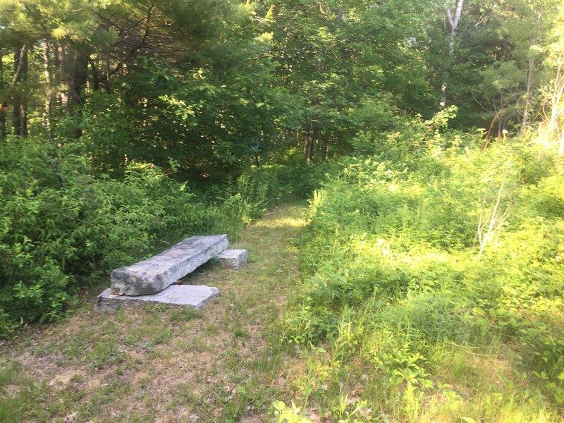 Take a break on this foundation stone bench seat