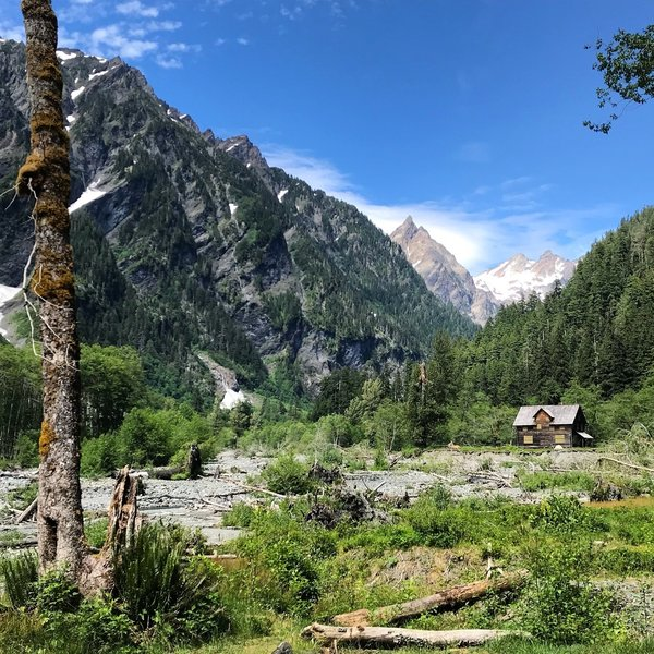 Walking into Enchanted Valley with the Chalet in view.