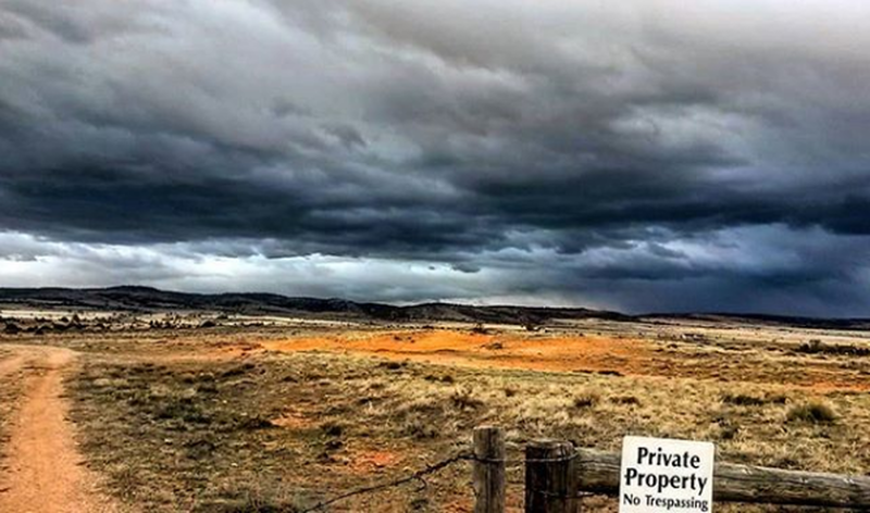 Pilot Hill looms under stormy skies