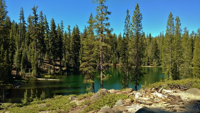 The blue-green waters of a small unnamed lake along Bear Lakes Trail.
