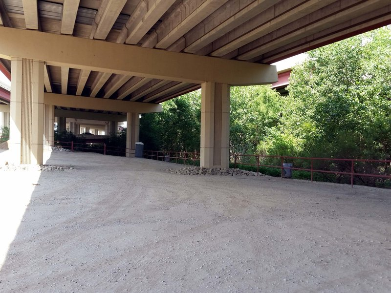 Parking, restroom, trash cans under the overpass