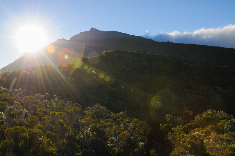 The sun begins to set behind Piton des Neiges in route to the Refuge