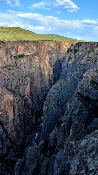 A wonderful contrast between the depths of the Black Canyon of the Gunnsion and the grasslands and blue skies above.