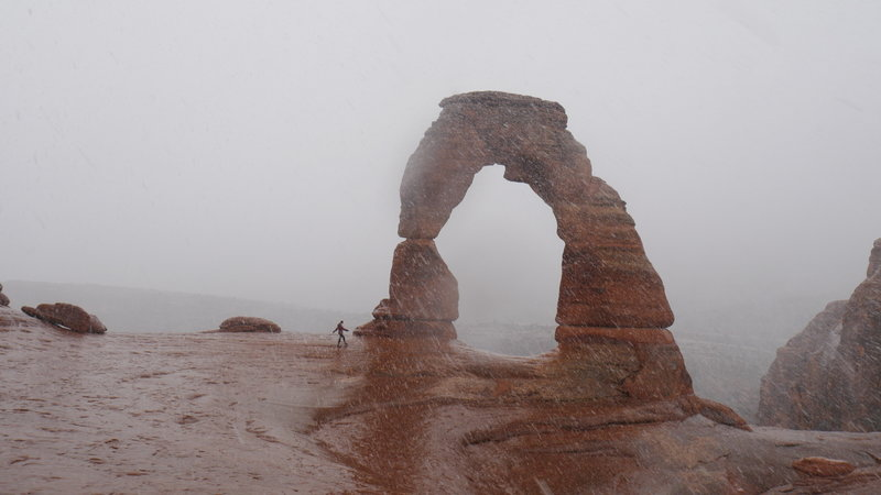 Rain and snow at Delicate Arch in February.