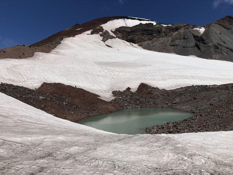 Tarn at the base of Lewis Glacier