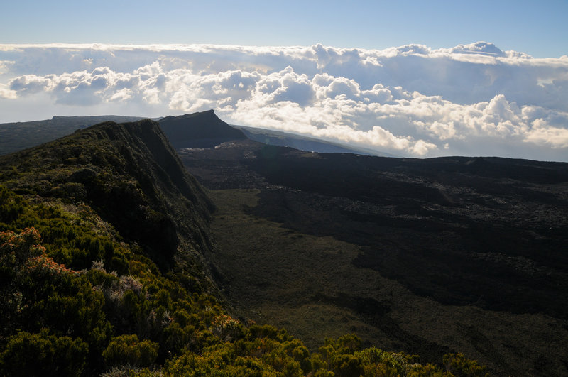 "Nez Coupe de Sainte-Rose is the last ""peak"" on Piton de la Fournaise's shield before Reunion drops into the cloud-covered ocean."