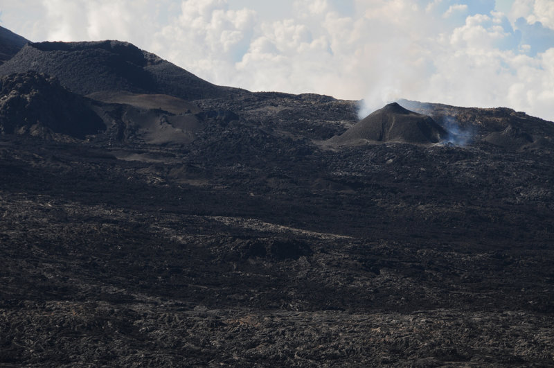 The 2018 eruption has formed a new spatter cone near a bunch of older cones.