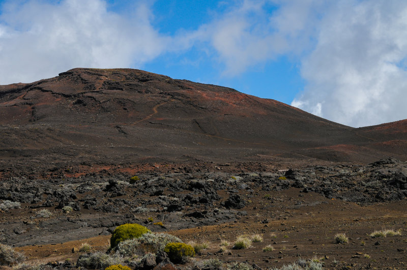 Piton Chisny's reds and browns look great against the blue sky in this martian landscape