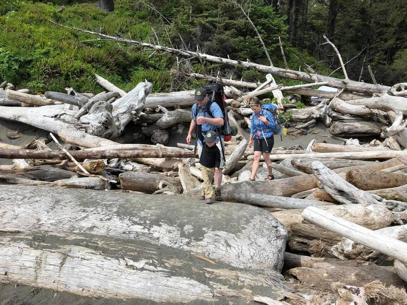 Crossing the driftwood pile to get to the beach