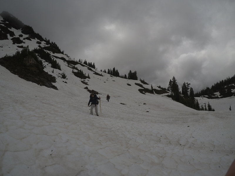 Hiking along the road, which is thoroughly covered in snow.