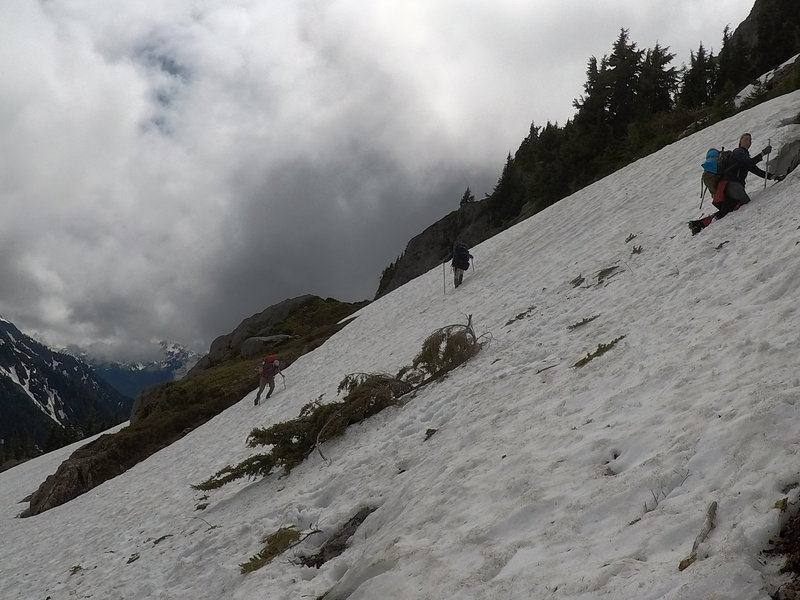 Climbing up a snow bank to the trail.
