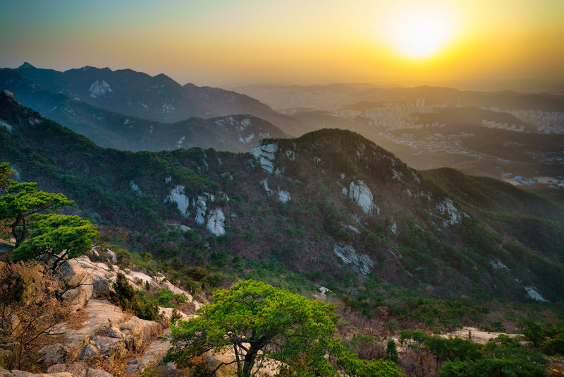 Sunset over Seoul on the northern ridge of the trail. The nearest ridgeline is the first half of the trail.