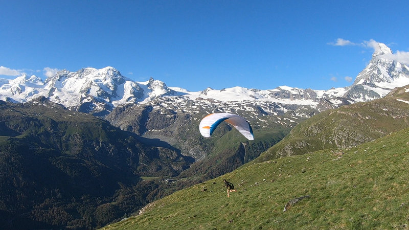A common paraglider launch from the grassy hillside