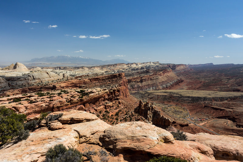 Waterpocket Fold from Navajo Nobs with Henry Mountains in the background