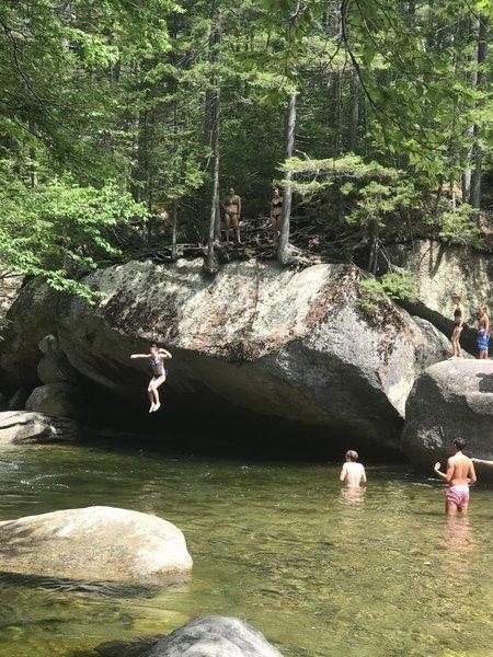 Jumping into swimming hole along Franconia Falls Trail