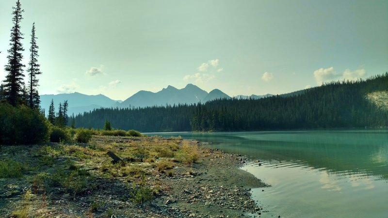 Early morning at Brazeau Lake, a large backcountry lake. This is the view looking southeast from the shoreline at Brazeau Lake Trail Camp.