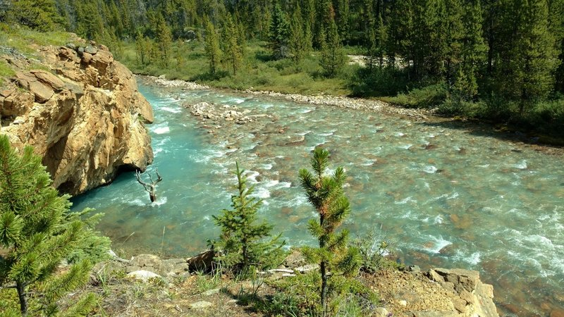 The Brazeau River runs below a rocky overlook on the South Boundary Trail.
