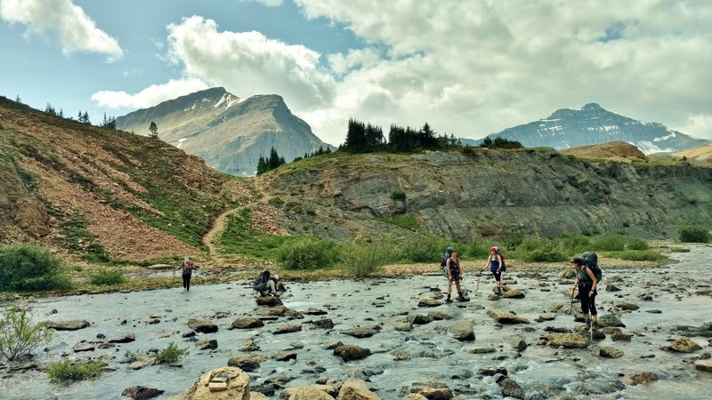 Now what? - Crossing the Brazeau River just below Nigel Pass. Two on the left take off their boots, three on the right rock hop it.