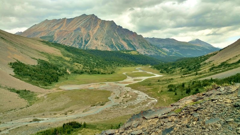 The Brazeau River runs through meadows at the base of the north side of Nigel Pass. This awesome view surprises upon rounding a bend in the trail when descending the pass.