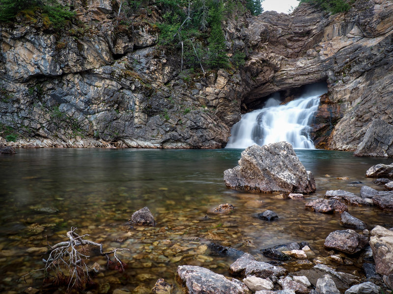 Running Eagle Falls (low flow, August) as the day turns to dusk. Near Two Medicine Lake.