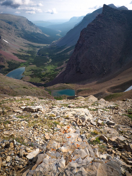 Looking out from Siyeh Pass into Boulder Creek Valley. Unnamed lakes (middle, left center) feed the creek which winds down into Saint Mary Lake.