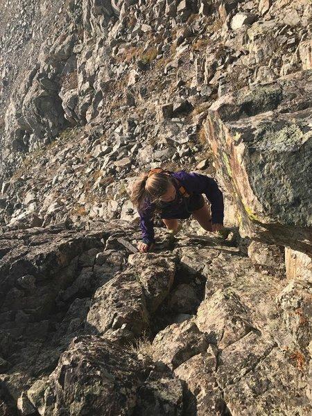 Jenna navigating the ridge on peak 1.