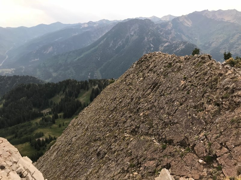 A cool rock slab off the side of Mount Raymond with Mount Kessler in the background and the south side of Big Cottonwood Canyon