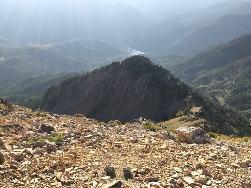 A cool rock formation just below the summit of Box Elder, with Tibble Fork Reservoir down below