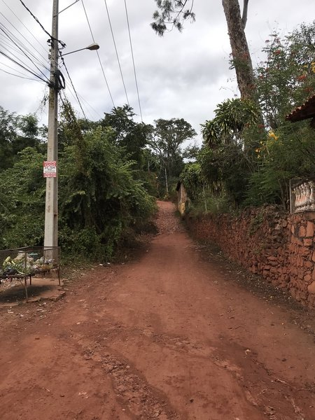 Paved road becomes dirt road