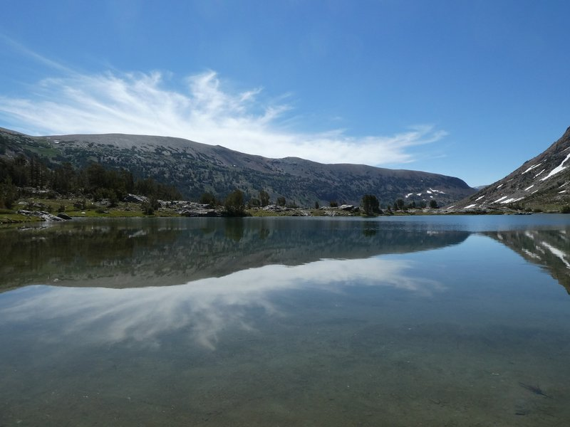 Heading along the east side of Saddlebag Lake in the morning, full of reflections when the wind isn't blowing.