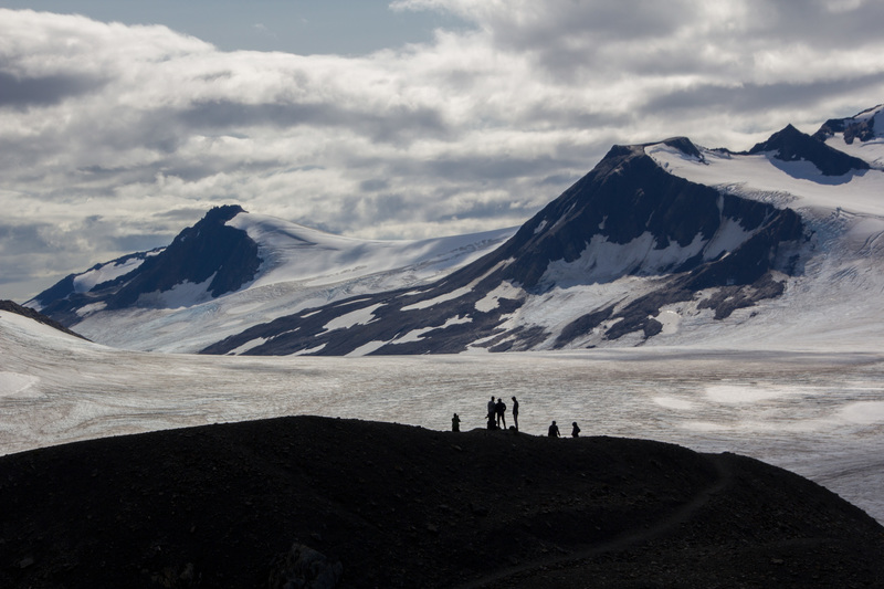 Hikers at the end of the trail, overlooking the ice field.
