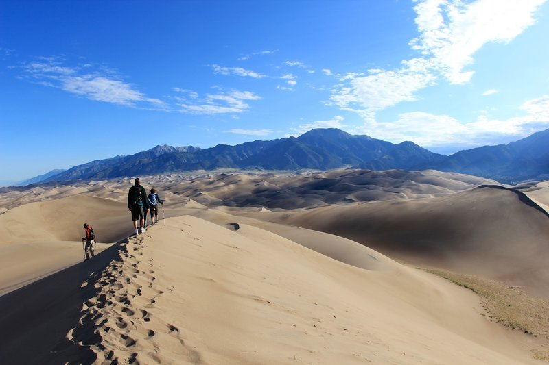 Group of hikers heading to Star Dune