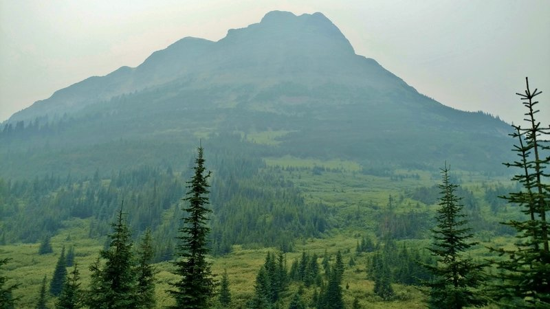 Tete Roche, the eastern-most peak of Yellowhead Mountain, as seen from the trail end on a hazy, overcast day.