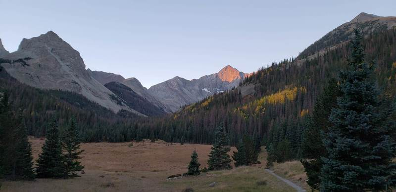 Sunrise in a meadow near the beginning of the Huerfano Trail