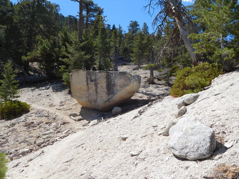 Upside-down boulder at start of steep climb to Twin Peaks.