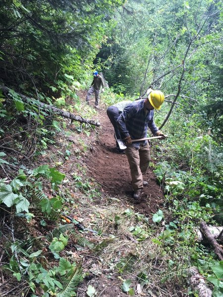 BMLT Blues Crew repairing the slope of the trail.