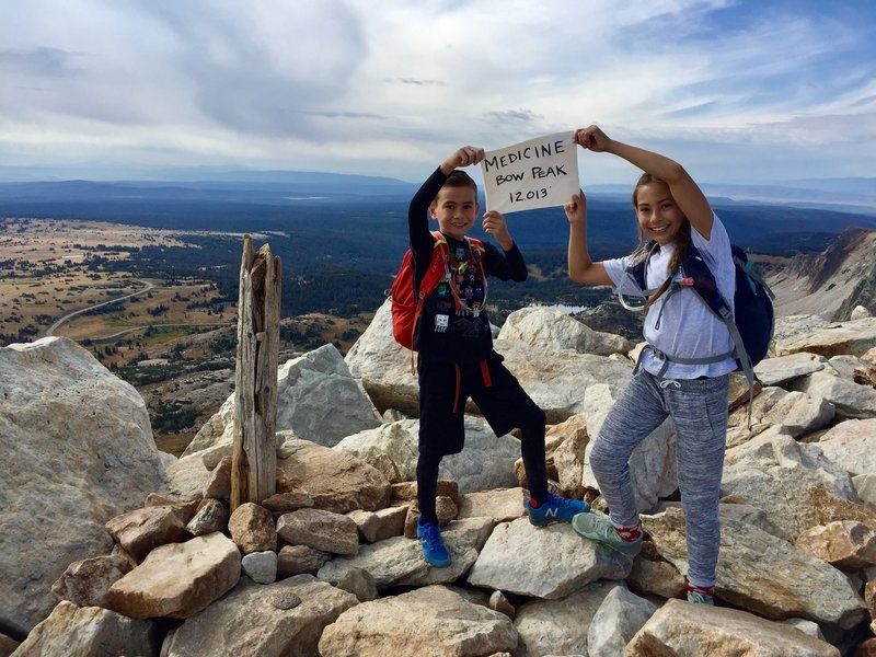 There was a sign for us to take a picture with at the summit of Medicine Bow Peak 12,013' 09/03/18 (Kids aged 12 and 9)