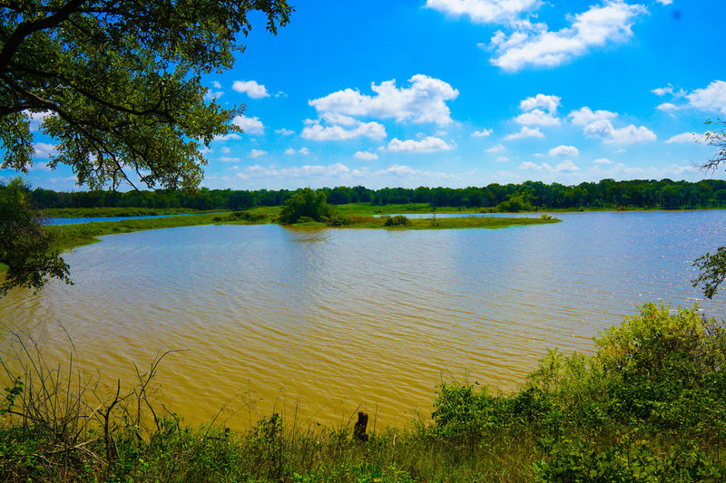 The view of an inlet of Lake Texoma from a well placed bench.