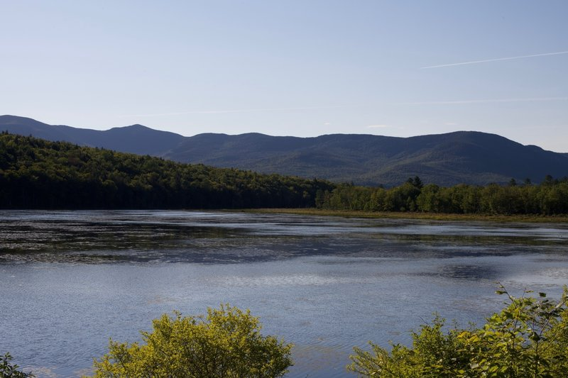 From a small bench on the side of the trail, the best view of Shell Pond and the surrounding mountains spreads out before you.