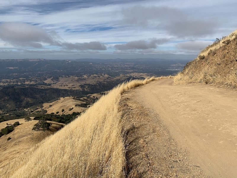 The route is well-kept and exposed, with sweeping views and occasional brisk gusts — especially close to the summit.