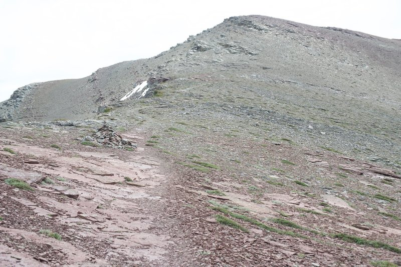 The trail is marked by cairns as it climbs up the side of the mountain.