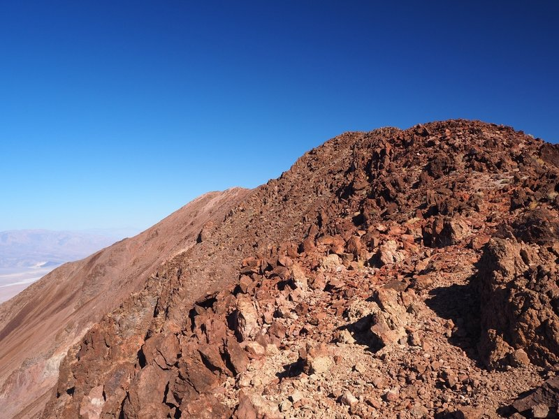 The trail gets steeper and rockier along the summit ridge